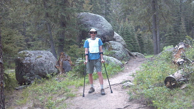 Dave hiking on a trail with forearm crut