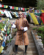 Dave Bexfield of ActiveMSers wearing a goh in Bhutan