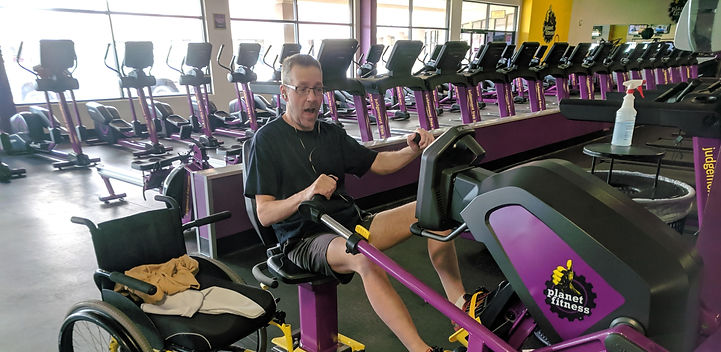 dave on exercise equipment at gym.jpg