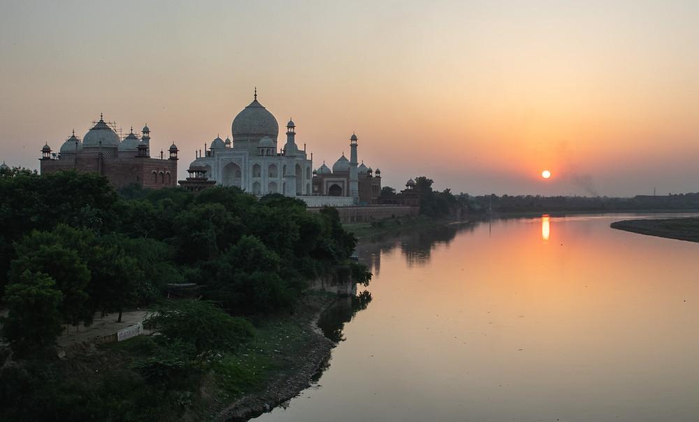 Sunset at the Taj Mahal over the Yamuna river