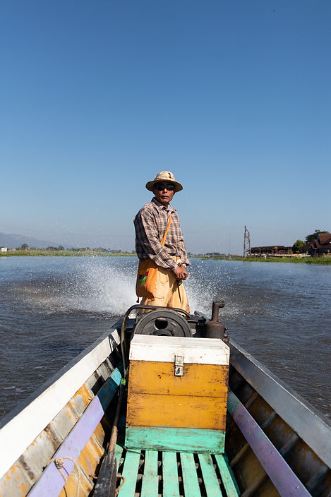 boat driver on the inle lake in myanmar. Picture by hungrigaufmeer