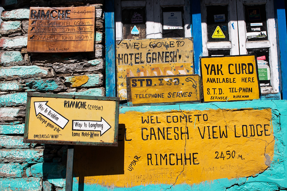 Which way? - Signs on our trek in the Langtang region (by HungrigaufMeer)
