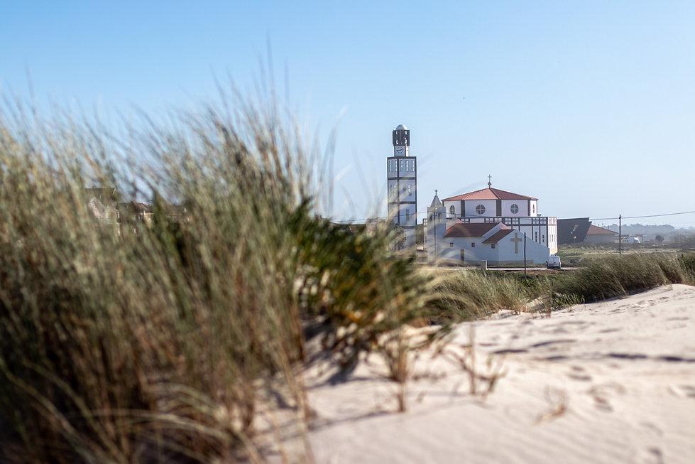 church in aveiro portugal right next to the sea