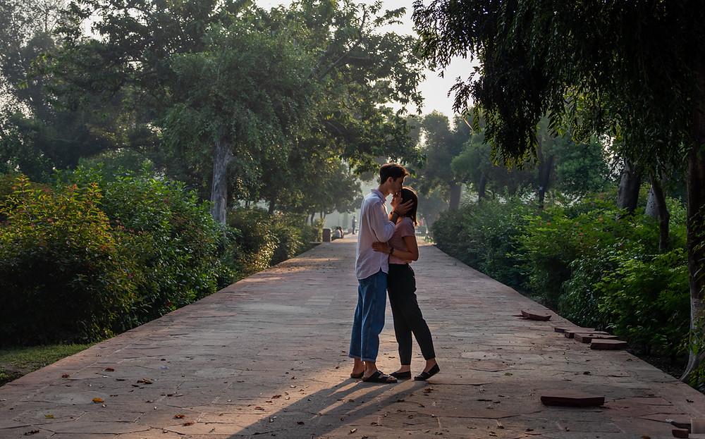 Couple in garden of Taj Mahal