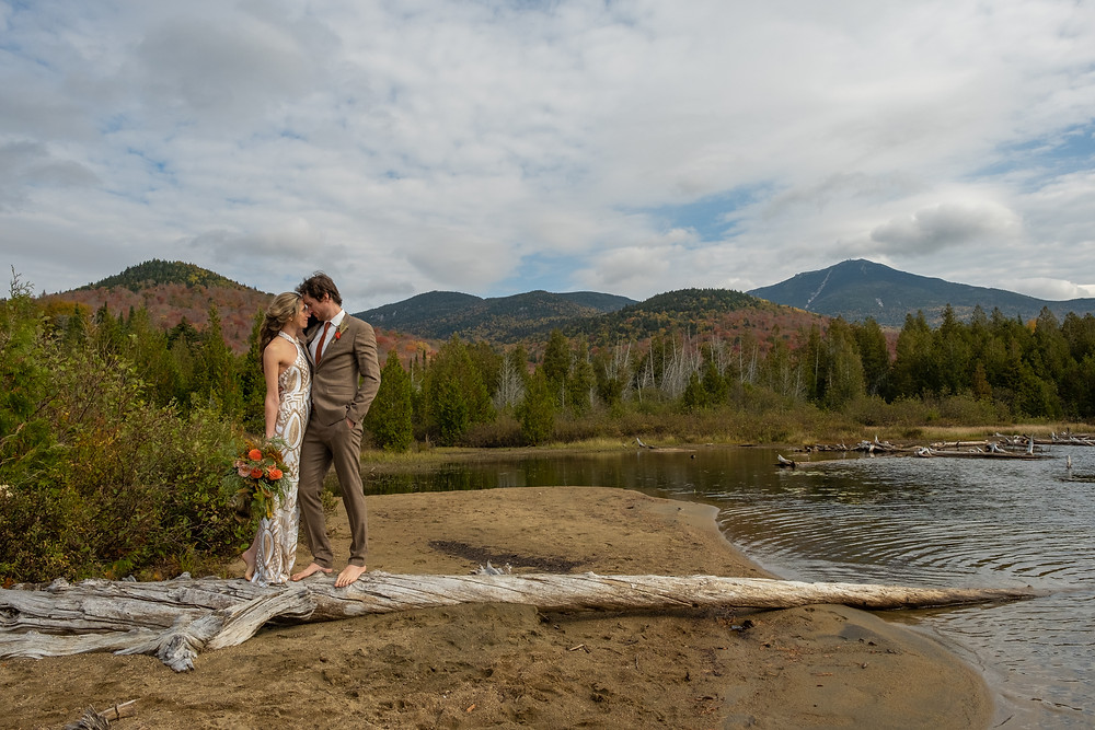 A Couple Elopes on a Beach Surrounded By Mountains in Upstate New York's Adirondack Mountains