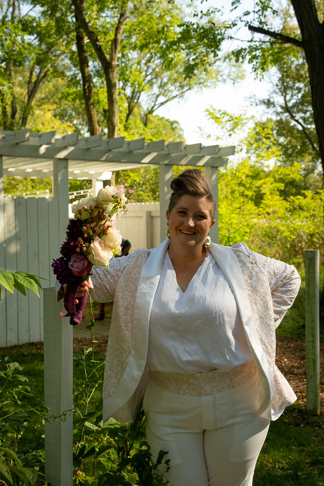 Portrait of an LGBTQ Bride in her wedding suit at the Blue Dress Barn in Benton Harbor Michigan
