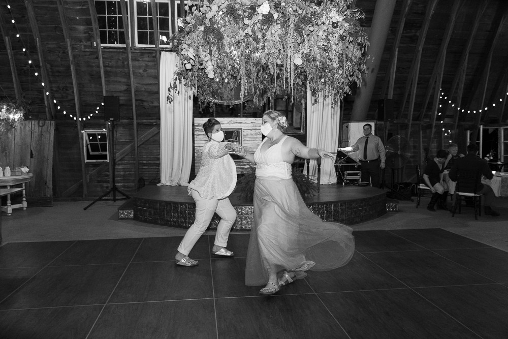Two LGBTQ Brides Share a First Dance at the Blue Dress Barn in Benton Harbor Michigan