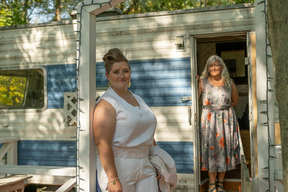 A bride and her mother outside of the getting ready RV at the Blue Dress Barn in Benton Harbor Michigan