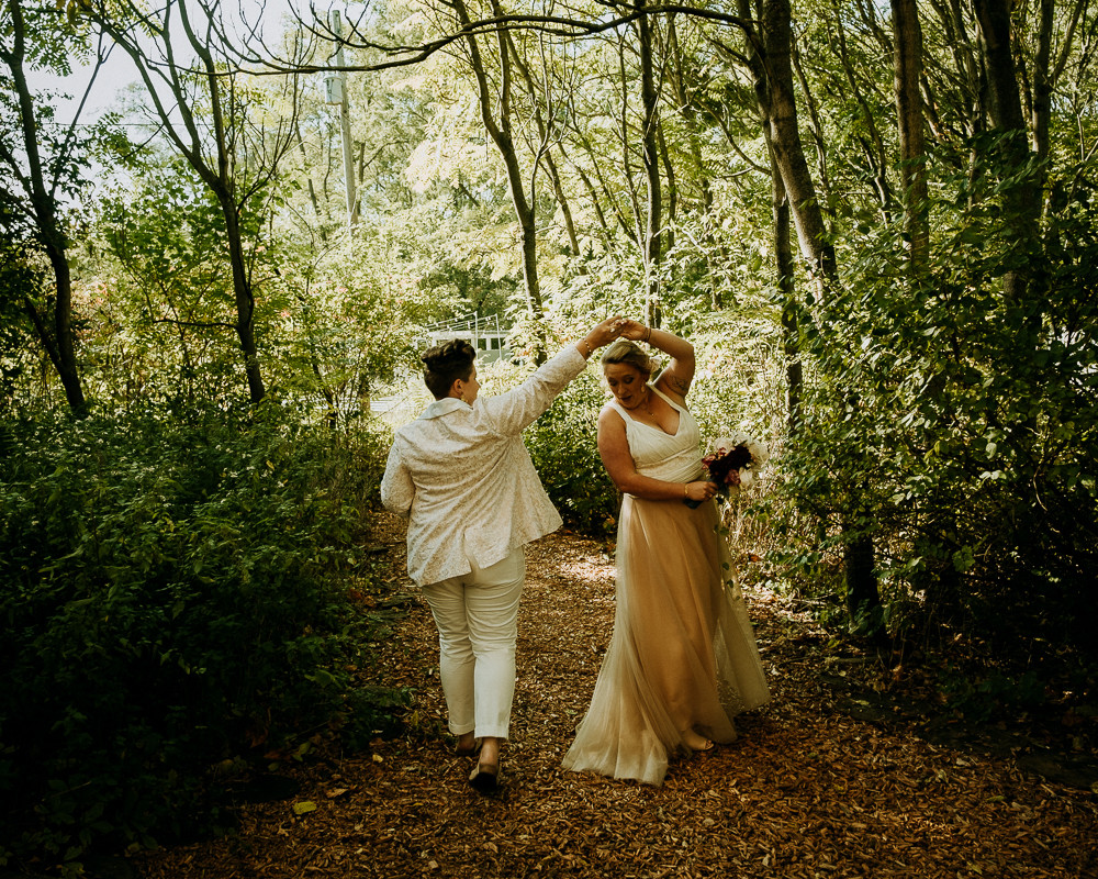 Two Brides Dance in the Forest in Benton Harbor Michigan