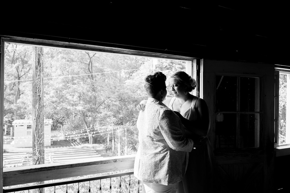 Two Brides Gaze at Each Other Lovingly While Getting Married in Benton Harbor Michigan