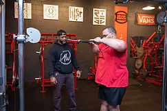 A young man getting trained by one of our personal trainers.