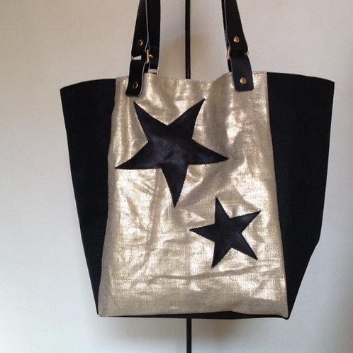 Grand sac à main en tissu noir imperméable et lin lamé doré.