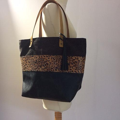 Sac boudoir en cuir noir grainé, cuir imprimé léopard et tissu d'ameublement