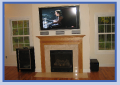 TV over fireplace with surround sound and a sonos system