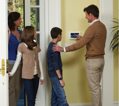 Family Using Alarm System