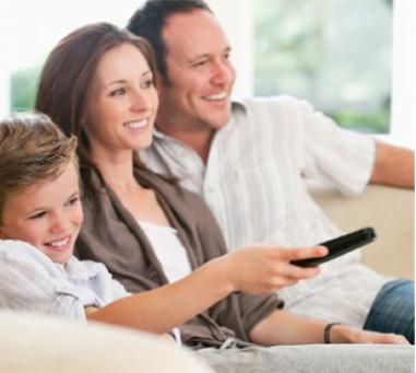 Family Enjoying Home Entertainment