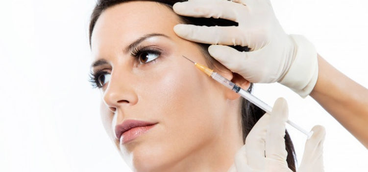 beautiful-young-woman-getting-botox-cosm