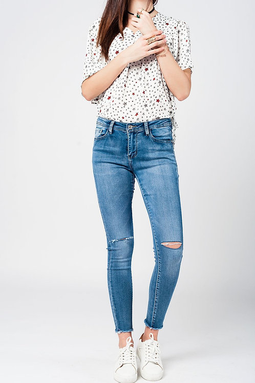 Skinny Jeans in Midwash With Busted Knees and Chewed Hems