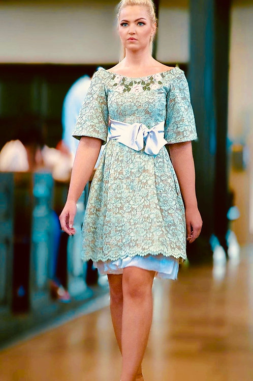 Lace dress, with neckline embroidery and satin belt.