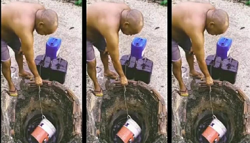 Morador tenta conseguir água em poço improvisado