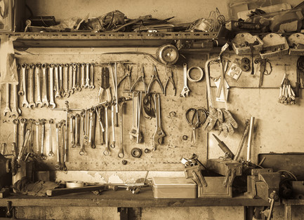 Old Tool Shelf Against A Wall Vintage Style.jpg