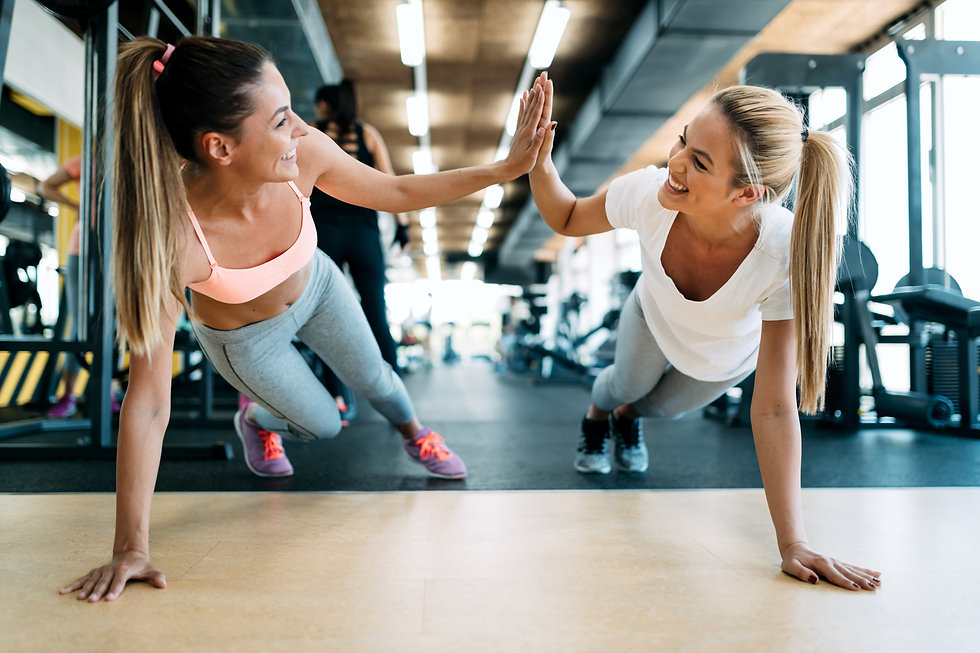 Two attractive fitness girls doing push