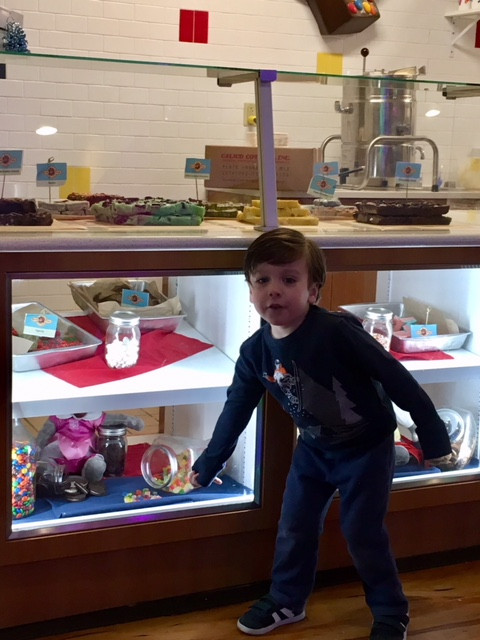 Picking out some ice cream toppings.