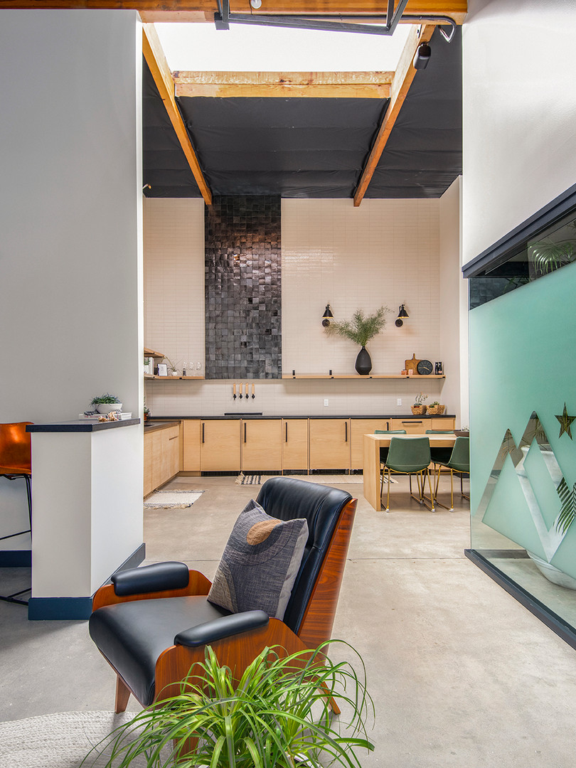 The light, airy floorplan flows from the inviting reception room into the modern kitchen-social area and on back through to the focused work space and quite phone pods