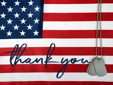 word thank you and military dog tags on