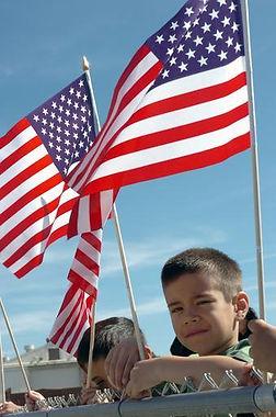 US_Navy_070301-N-7365L...g_American_flag