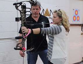 Tracy doing an introduction to Archery Class