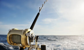 Close-up of a fishing reel on the boat_e