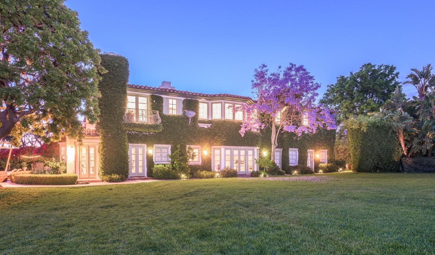 Back of mediterranean villa ivy lawn.jpg