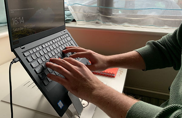 case study laptop with hands cropped.jpg