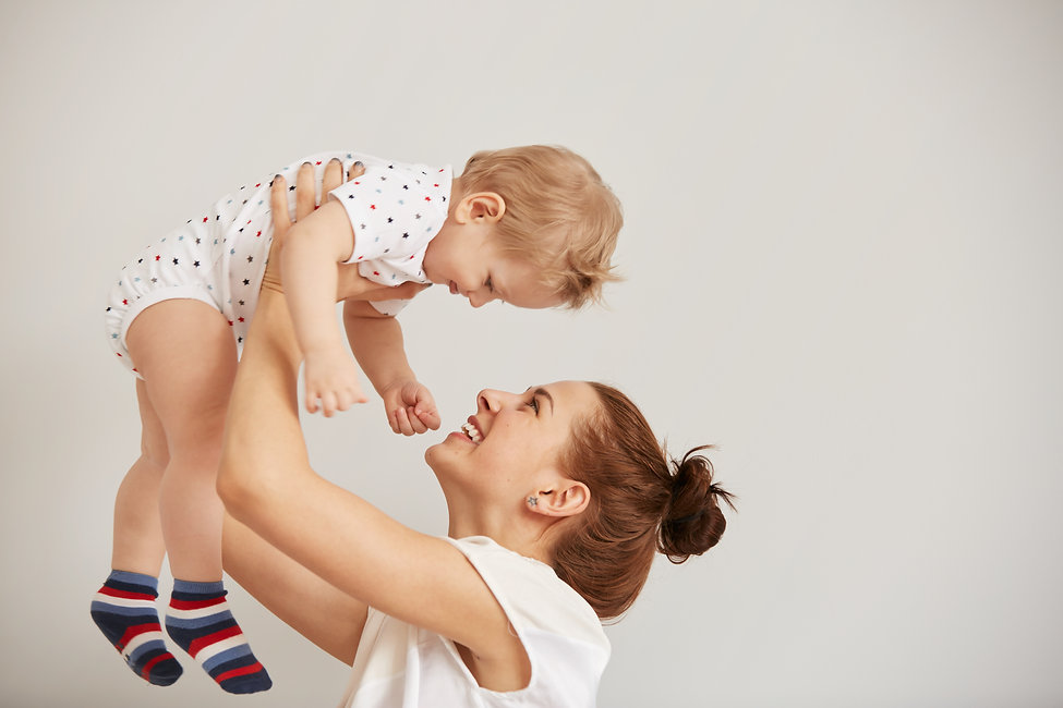 young-mother-playing-with-her-little-bab