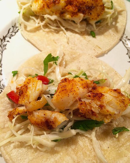 Pan-fried Fish Tacos with pickled white cabbage, cilantro and fresh chilles.