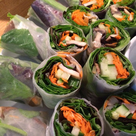 Fresh Spring Rolls with Carrots, Cucumber, and Baby Greens.