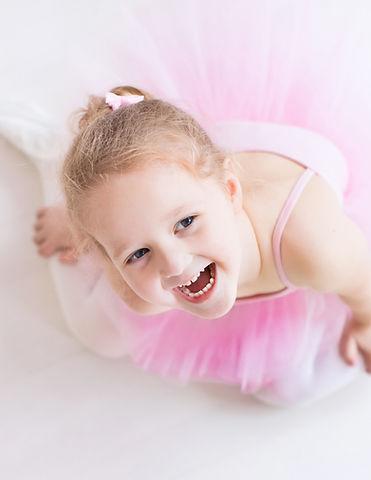 Little ballerina girl in a pink tutu. Cu