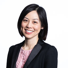 Photo of Rosie Yeung in black suit jacket and pink shirt.
