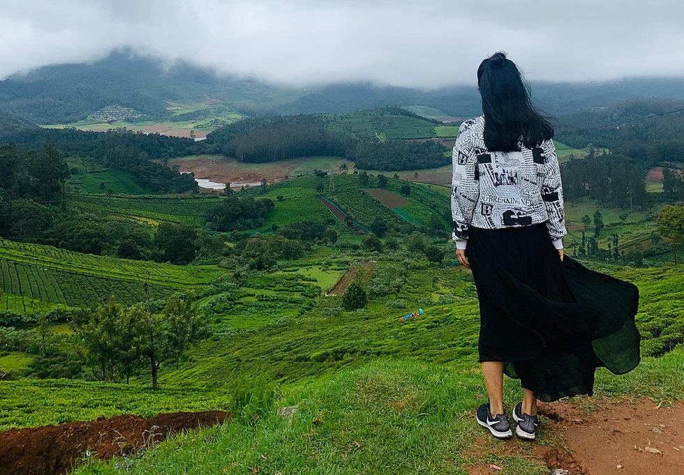 Woman looking at tea garden