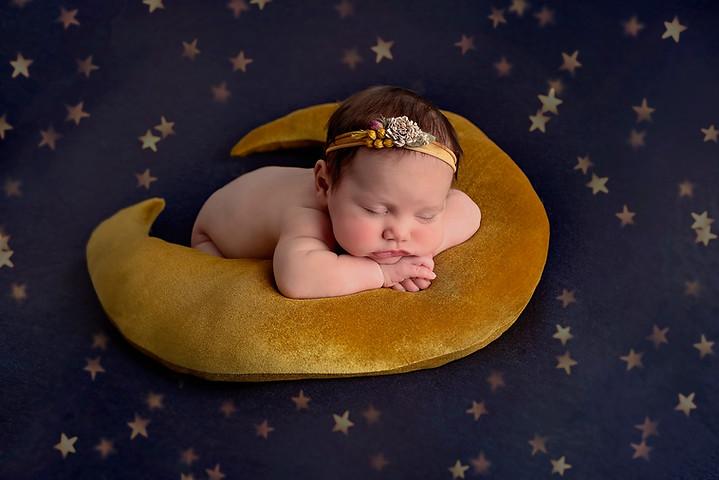 stunning baby on moon prop