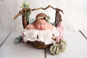 newborn photoshoot wirral, baby in prop, pink and green