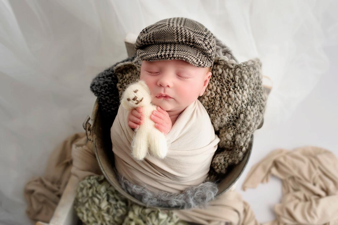 newborn with hat on