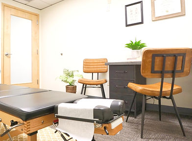 chiropractor office, adjustment table, chairs, office plants