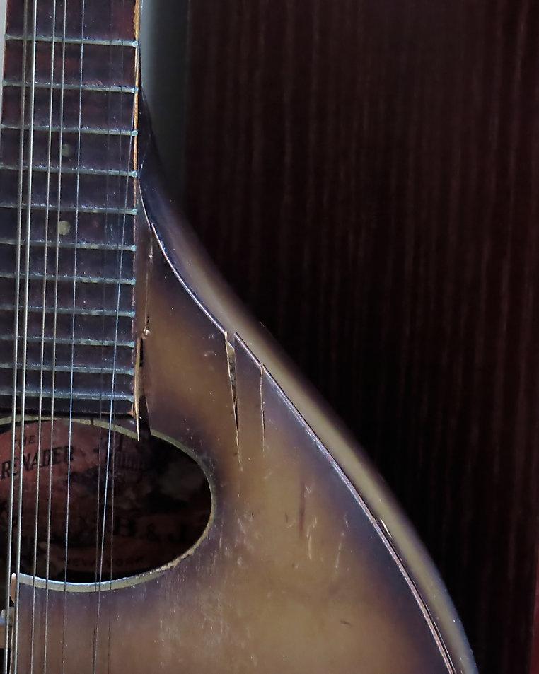 Photograph of a Broken Mandolin,photo by Jodi DiLiberto