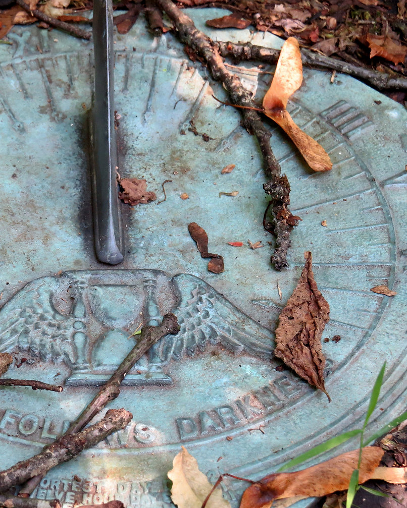 Photograph of a sundial on an Autumn Day. Photo by Jodi DiLiberto