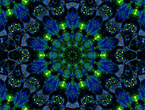 Image of a brilliant green and royal blue mandala in a circular pattern by Jodi DiLiberto