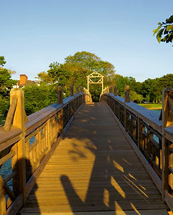 Photograph of one of the bridges across Spring Lake on a late afternoon in late summer, Photo by Jodi DiLiberto