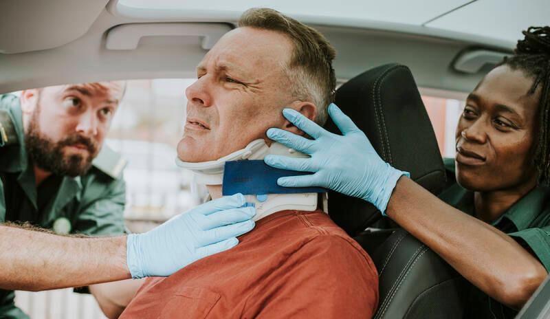 paramedic placing a foam collar on man