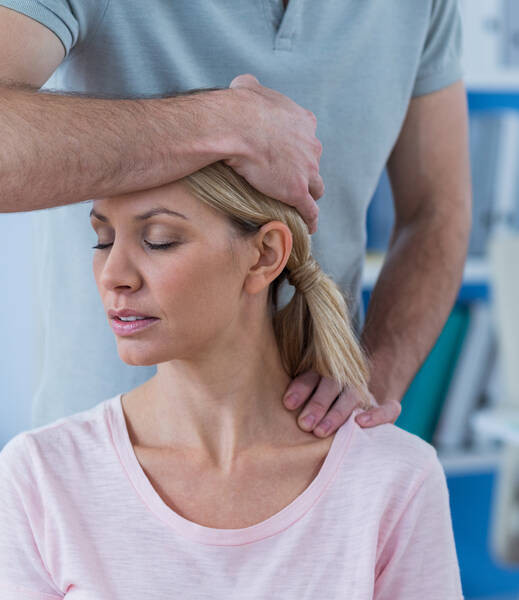 stretching patient neck for neck pain relief